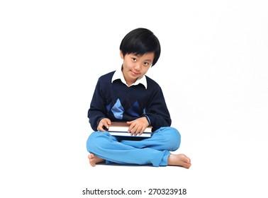 Cute Asian school boy model posing in casual wear