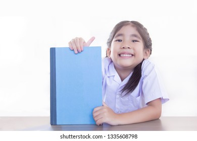 cute asian school girl hold book present or recommend on white background