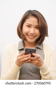 cute asian woman with cellphone