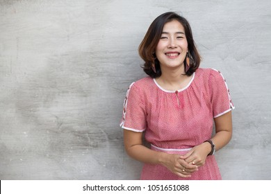 The cute Asian woman are thinking something on gray background