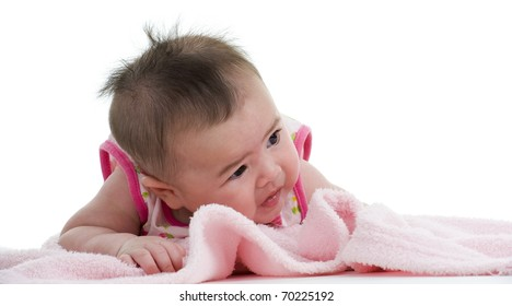 cute asian-caucasian baby on pink towel, isolated on white background