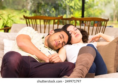 cute attractive couple lying resting sleeping couple sofa