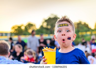 Cute Australian boy with flag tattoo on his face on Australia Day celebration in Adelaide