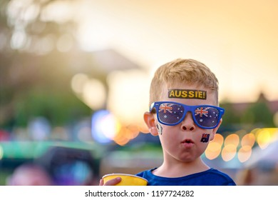 Cute Australian boy with flag tattoo on his face on Asutralia Day celebration in Adelaide
