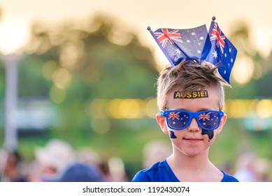 Cute Australian boy with flags and tattoos on his face on Australia Day