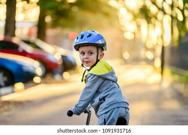 Cute australian child riding his bicycle and wearing helmet on a day in Glenelg, South Australia