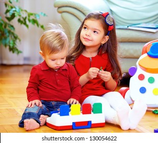 cute babies playing toys at home