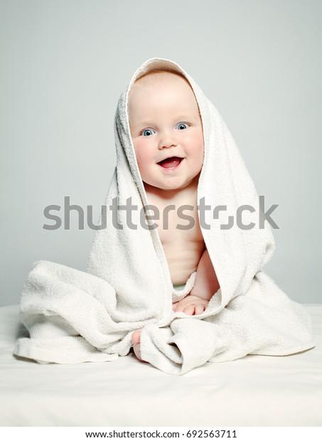 Cute Baby after Bath, Parental Care Concept. Happy Baby having Fun