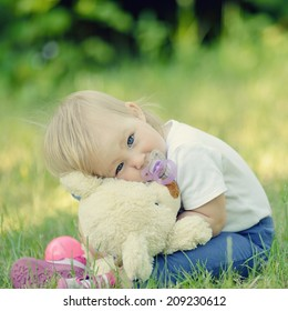 Cute baby with blue eyes hugging a mascot.  MANY OTHER PHOTOS FROM THIS SERIES IN MY PORTFOLIO.