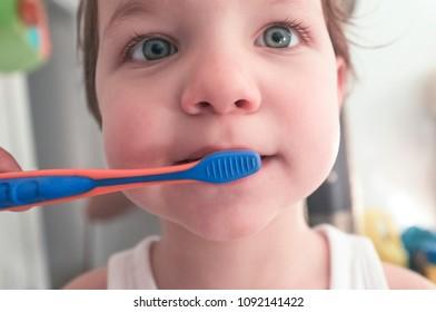 Cute baby boy brushing teeth in the bathroom. Soft noise at 100%