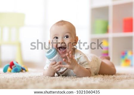 Cute Baby Boy Drinking Bottle Kid Stockfoto Nu Bewerken 1021060435