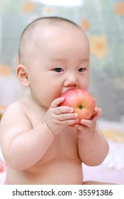 cute baby boy  eat red apple