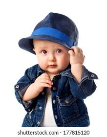 Cute baby boy holding hat