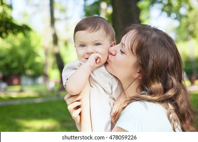 Cute baby boy less 1 year with his mom in summer park