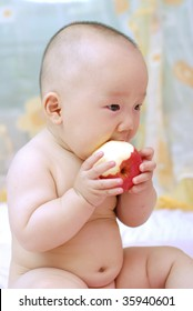 cute baby boy open his mouth to eat red apple