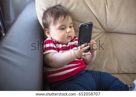 cute baby boy phone stock photo edit now 652058707 shutterstock