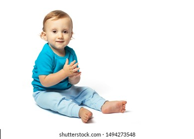 Cute baby boy playing isolated on the white background. Copy place