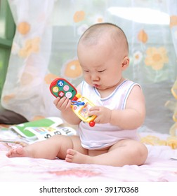 cute baby boy playing toy