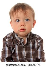 Cute baby boy wearing a plaid shirt.