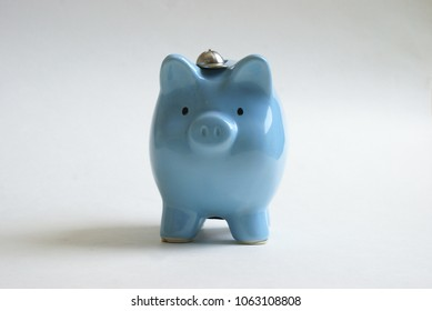 A cute baby boys blue piggy bank for future investments.