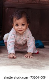 Cute baby crawling with kajal eyes, Kathmadu, Bhaktapur, Nepal, October 09, 2013
