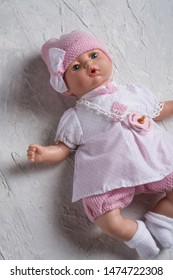 cute baby doll tot with dummy around white background