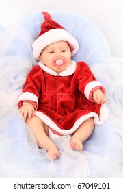 Cute baby dressed as Santa. Great for calender and christmas greetings.