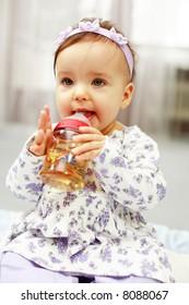 Cute baby is drinking tea