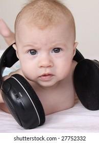 Cute baby with earphones