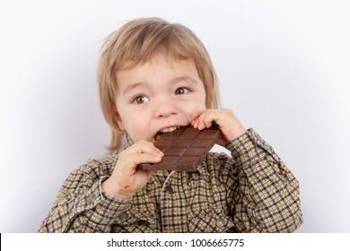 Cute baby eating chocolate