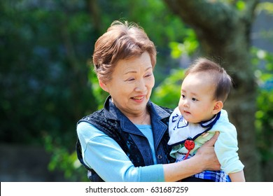 Cute baby and the elderly