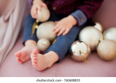 cute baby feet and Christmas decorations