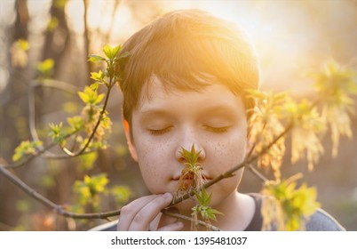 Cute baby with freckles on her face breathes spring fresh air. Allergy, Healthy, lifestyle, earth hour, ecology concept.