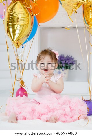 Cute Baby Girl 1 2 Year Old Sitting On Floor With Pink Balloons In Room