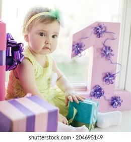 cute baby girl celebrating first birthday