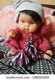 cute baby girl doll in handmade wollen dress