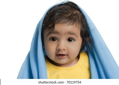 Cute Baby Girl Draped in Blue Blanket, Isolated, White