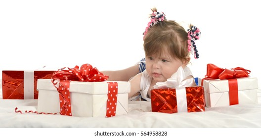 Cute baby girl  with gifts