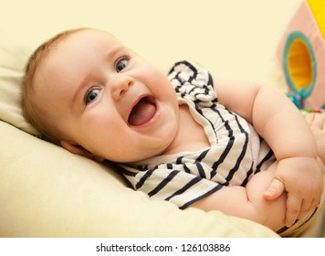 cute baby girl having fun laughing and playing toy