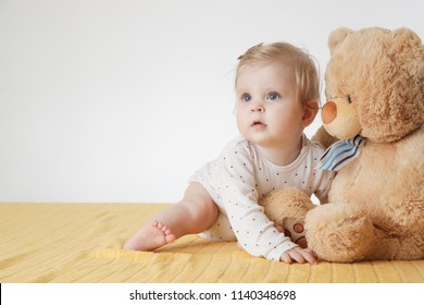 Cute baby girl with her teddy bear