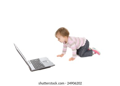 cute baby girl with laptop on white background