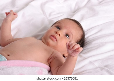 cute baby girl laying and looking over