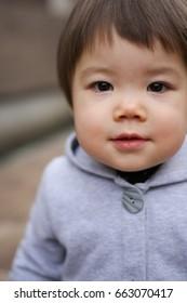 Cute baby girl looking at camera.