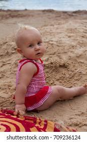 cute baby girl on a beach