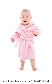 cute baby girl in pink bathrobe after bath standing isolated on white background