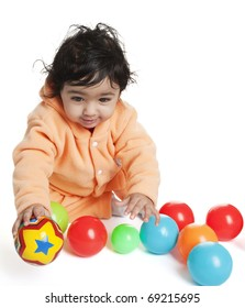 Cute Baby Girl Playing with Colorful Balls, On White
