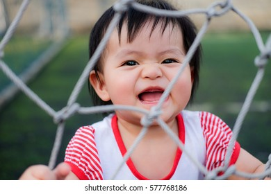 Cute Baby girl playing in the football field, close-up portrait, Portrait of a beautiful baby girl.