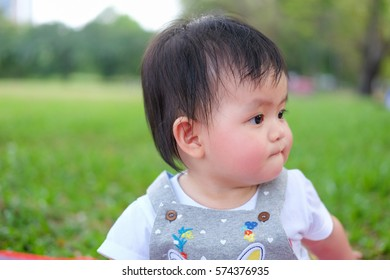 Cute Baby girl playing in the garden, close-up portrait, Portrait of a beautiful baby girl