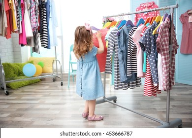 Cute baby girl in baby shop store