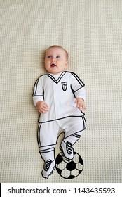 Cute baby girl sketched as footballer